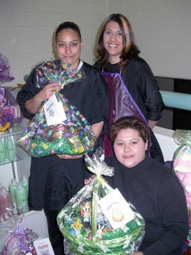 Crysta Avila (standing, left) and Kristen Perea (standing, right), both Cosmetology students, helped with the effort, as did Cosmetology Administrative Assistant Denise Silva.